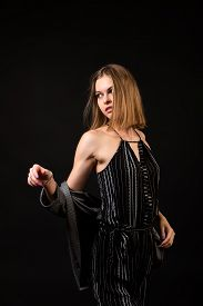 Woman Model Teaches To Pose. High Fashion Model Girl  Posing In Studio, Portrait Of Beautiful Woman