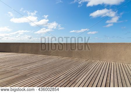 Empty Promenade With Wooden Floor And Concrete Railing At The Sea Coast On A Sunny Day. Background P