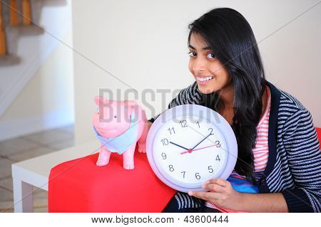 Girl holding clock in indoors