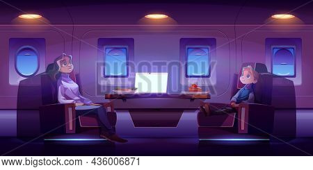 Mother With Daughter Travel By Airplane. Passengers Sitting At Comfortable Seats With Table In First