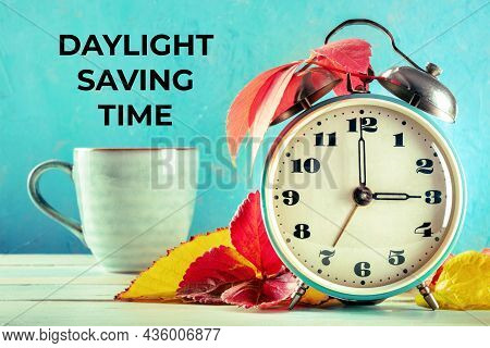 Daylight Saving Time Concept, Fall Back In Autumn. A Vintage Alarm Clock With A Mug Of Coffee And Au