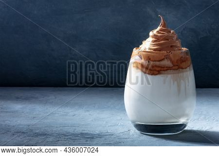 Dalgona Cold Coffee On A Dark Blue Background With A Place For Text. Trendy Korean Summer Drink