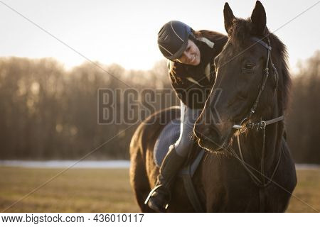 Female horse rider riding outdoors on her lovely horse