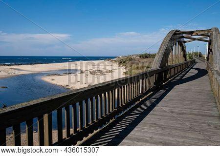 On the wooden Lombard Bridge in Labruge, Vila do Conde, Portugal.