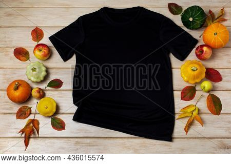 Unisex Black T-shirt Mockup With Fall Decor