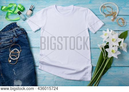 White Womens Cotton T-shirt Mockup With White Lilies, Bijouterie And Nail Polish. Design T Shirt Tem