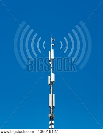 Telecommunication Cell Tower Antenna Against Blue Sky Background. Wireless Communication And Modern