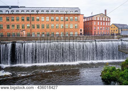 Cityscape Of Old Industrial Buildings With Waterfall And Water Reservoir In The City Of Norrkoping S