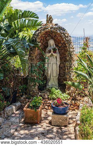 Haifa, Israel. June 17, 2021: The Statue Of Virgin Mary In The Garden Of Muhraka Monastery Of The Ca