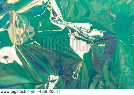 Turquoise Holographic Background. Wrinkled Foil Material. Soft Focus Fluid Waves.