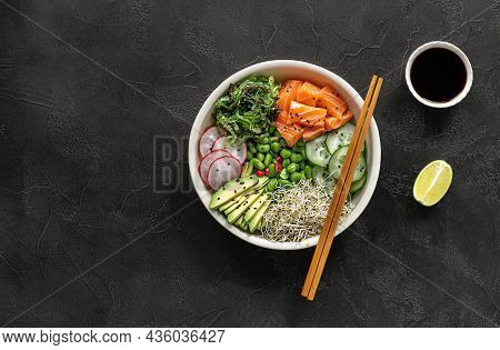 Keto Diet Poke Bowl With Salmon, Avocado, And Edamame Beans. Over Dark Background. Top View, Copy Sp