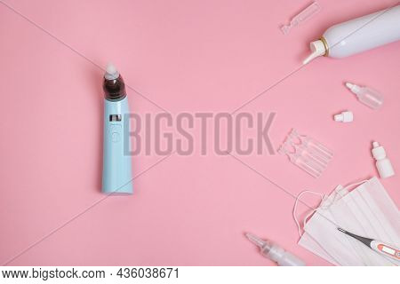 Different Types Of Medical Drops, Nasal Spray Or Blue Aspirator On Pink Background. Pediatrics Conce