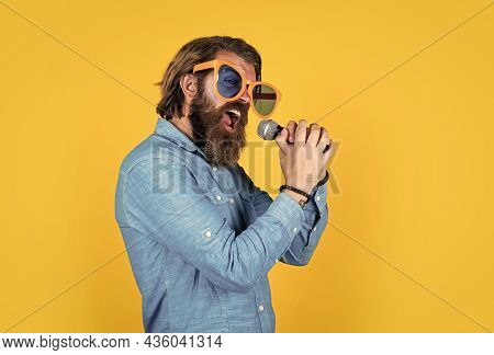 Get A High Note. Brutal Male Hipster With Microphone. Vocal School. Favorite Music Style. Concept Of