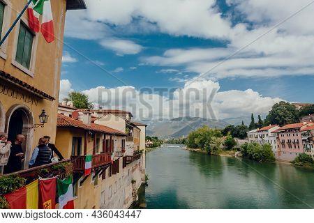 Bassano Del Grappa, Italy: Landscape Of Italian Town In Veneto And Some People Having Fun On Restaur