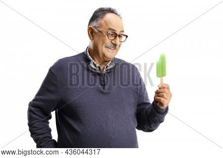 Happy mature man holding an ice lolly isolated on white background