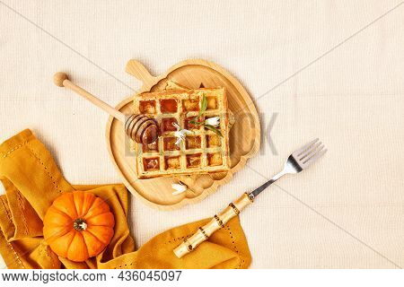 Healthy Autumn Breakfast. Pumpkin Spice Belgian Waffles With Orange Honey On Bamboo Plate A Shape Of