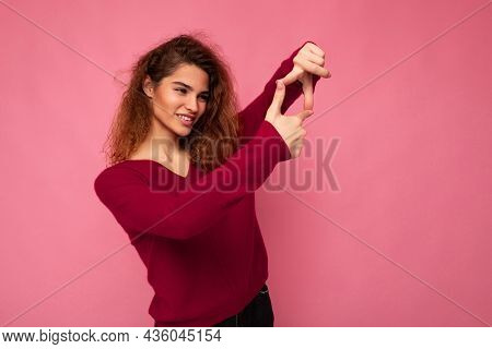 Portrait Of Young Positive Pretty Brunette Curly Woman With Sincere Emotions Wearing Trendy Pink Pul