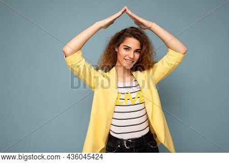 Photo Shot Of Young Positive Happy Attractive Brunette Curly Woman With Sincere Emotions Wearing Tre