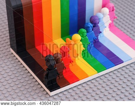 Tambov, Russian Federation - August 12, 2021 Eleven Lego Monochrome Minifigures Against A Rainbow Ba