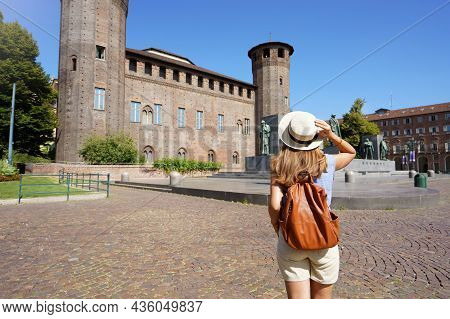 Traveler Exploring The City Of Turin In Italy. Woman Walking And Discovering Old Landmark In Europe.