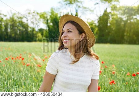 Restoring Herself To Nature. Young Woman Breathing And Relaxing In Nature.
