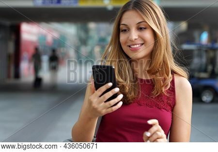 Close-up Of Charming Beautiful Business Woman Smile In Casual Style Using Smartphone Walking In Trai