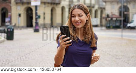 People And Technology. Panoramic Banner Of Cheery Smiling Student Girl Walking Against Old Style Cit