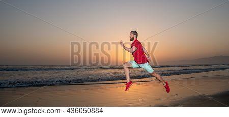 Sportsman Sprinter Running On Sunrise Summer Beach At Ocean, Copy Space, Stamina