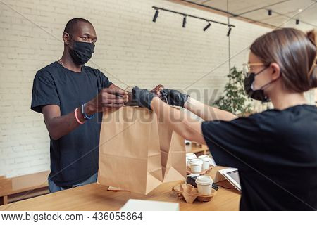Barista Transfering Orders Of Visitors To Courier