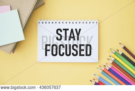 Stay Focused Text On Notebook And Other Office Equipment Such As Computer Keyboard