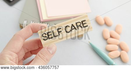 Self Care Words Printed On Wooden Blocks, Self Treatment Concept, Blue Background