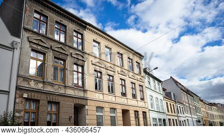 Building Renovation: Renovated Next To Unrenovated Old Building In The Historic Old Town Of Wismar,