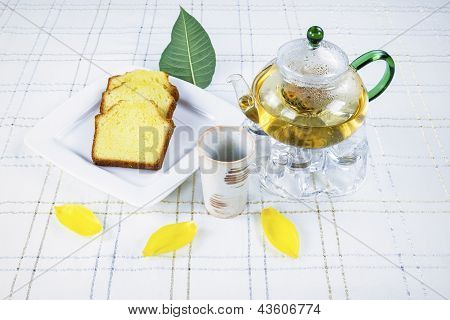 Green Tea And Cake On Table With With Flower Leafs