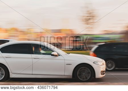 The White Bmw 5 Series Driving On The Street At High Speed Close Up. Motion Blur. Riga, Latvia - 07