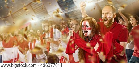 Emotive Football, Soccer Fans From England Cheering Their Team With White Red Scarfs At Stadium. Con