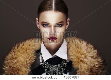 Beautiful Fashionable Strict Fashion Model In Fur Coat. Luxury