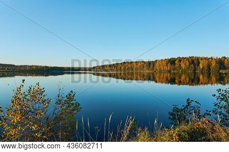 Blue Lake Among The Forest And Plain. Autumn Forest On The Shore Of The Lake. Clear Blue Sky On A Ca