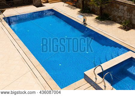 Outdoor Pool With Blue Water Without People.