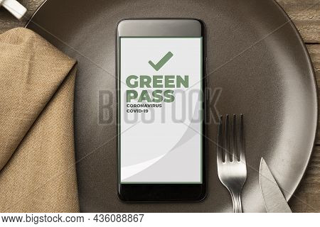 Green Pass In Restaurant Bar And Pubs: Smartphone Inside A Plate With Fork, Knife And A Handkerchief