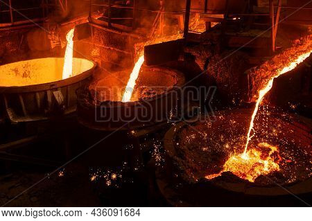 Blast Furnace Slag And Pig Iron Tapping. Molten Metal And Slag Are Poured Into A Ladle. Metallurgica