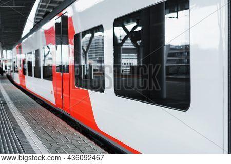 Wagons A Modern High-speed Train Stands On A Platform.