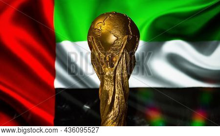 October 6, 2021, Abu Dhabi, Uae. Fifa World Cup Against The Background Of The Flag Of The United Ara