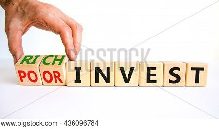 Rich Or Poor Invest Symbol. Businessman Turns Cubes And Changes Words Poor Invest To Rich Invest. Be