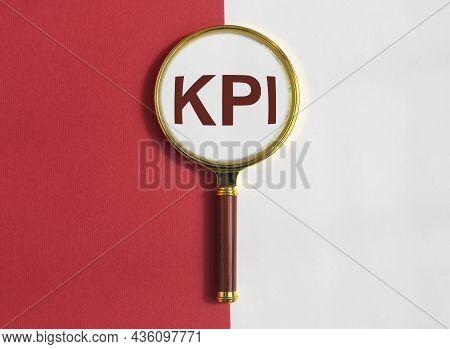 Kpi, Key Performance Indicator Word Acronym Through Magnifying Glass.