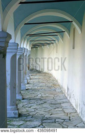 VINAGORA, CROATIA - OCTOBER 18, 2013: The arcades around the Parish Church of the Visitation of the Virgin Mary in Vinagora, Croatia