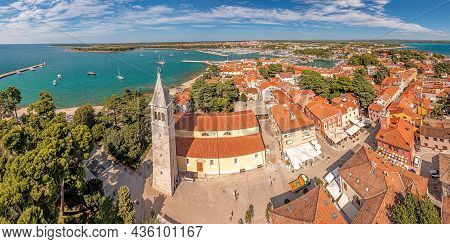 Drone Panorama Over The Roofs Of The Croatian Coastal Town Of Novigrad With Harbor And Church During