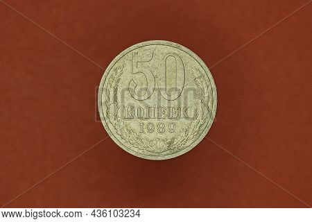 Old White Soviet Coin Fifty Kopecks On Brown Background
