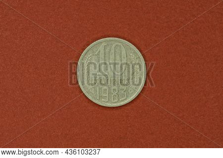 Old Gray Soviet Coin Ten Kopecks Lying On A Brown Table