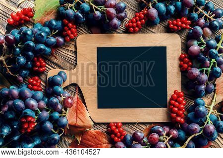 Bright Autumn Background Of Grapes And Lemongrass With A Copy Space. Top View.