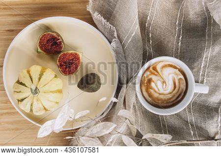 Cup Of Coffee Latte Macchiato And Pumpkin With Fig Fruits On A Yellow Plate. Autumn Flat Lay, Hot Dr